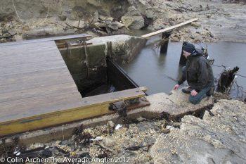 Paul Eidman checking a spot for restoring river herring access point.