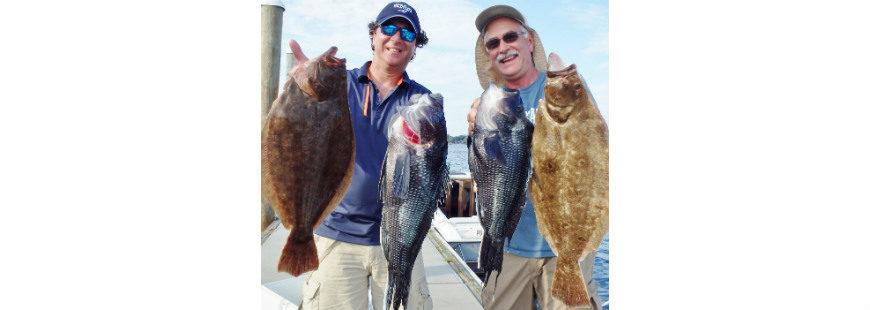 Steve Brustein of West Warwick and Kevin Fetzer of East Greenwich with summer flounder (fluke) and black sea bass they caught when fishing the Block Island Wind Farm area.