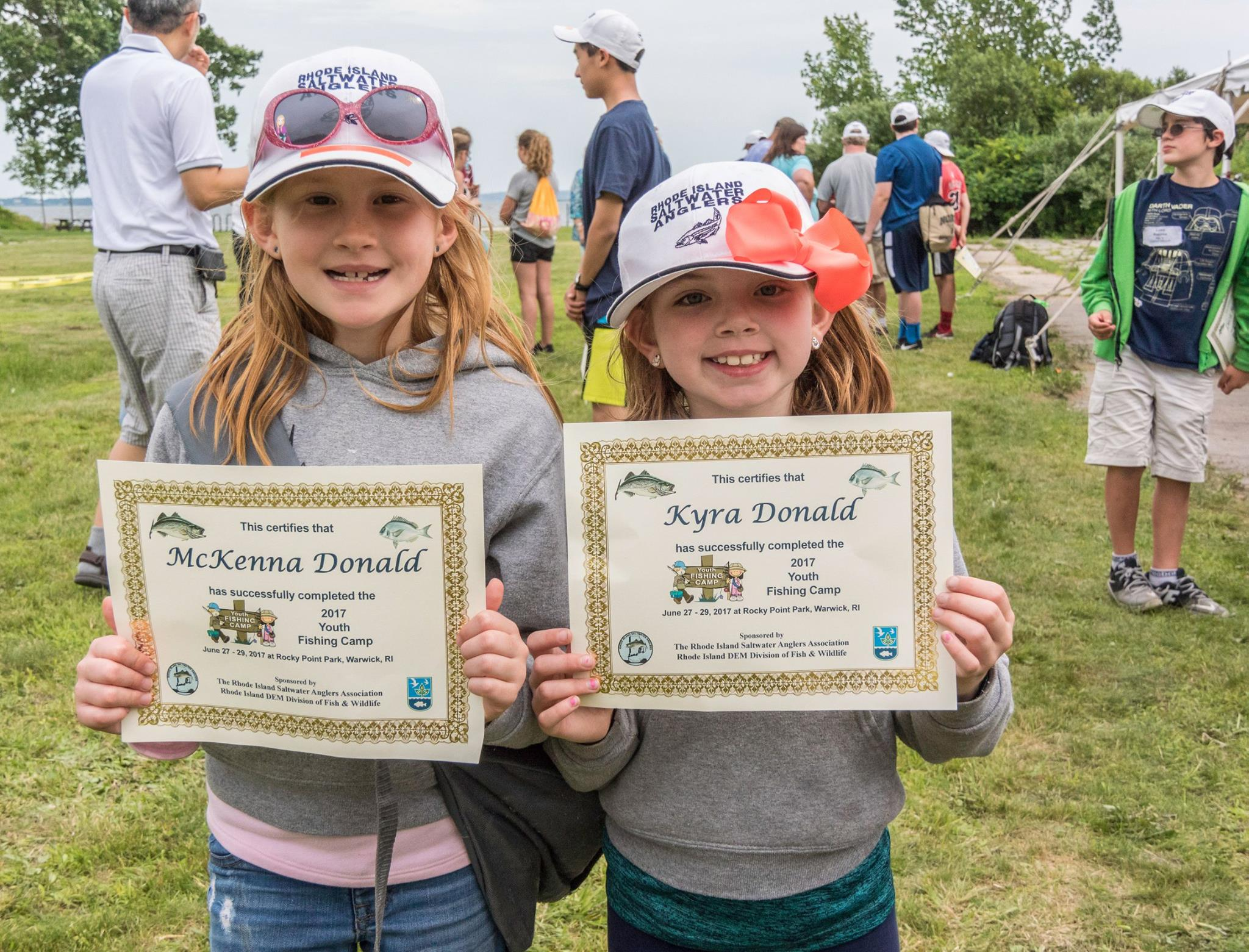 The Donald sisters (McKenna and Kyra) proudly display their RISAA Fishing Camp graduation certificates.
