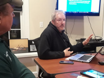 Capt. Rick Bellavance, president of the RI Party & Charter Boat Association, relates the advantages of electronic catch recording as Capt. Joe Bleczinski looks on.