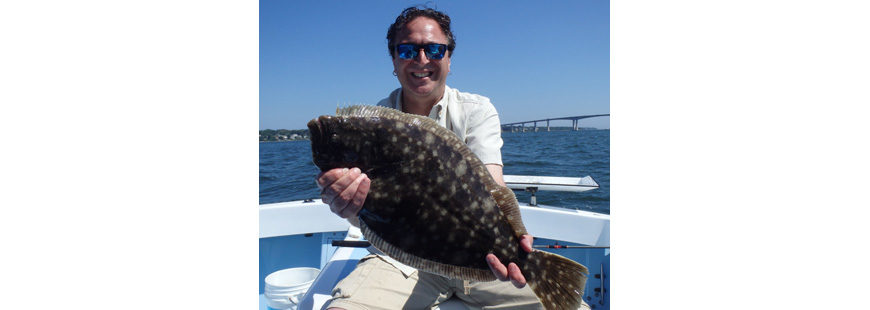 "Steve Brustein of Portland, ME with a 23"" summer flounder (fluke) caught last month north of the Jamestown Bridge in Narragansett Bay, RI."