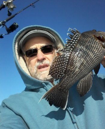 Kevin Fetzer with a black sea bass caught off Block Island last November.