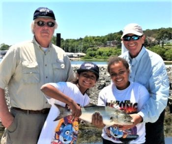 Over 250 RISAA volunteers are needed to run your average Take-A-Kid Fishing Day and about 50 volunteers are needed to run its three-day camp program for youth. Children shown with bluefish.