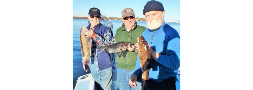 """Everyone who catches a fish is happy, and this brings me joy,"" said Capt. Dave Monti. Here Walt Galloway (with tautog), David Hansen (black sea bass) and Gerald Pesch (cod) caught three species when fishing off Newport, R.I., thanks in part to the Magnuson-Stevens Act."