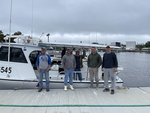 Pictured left to right - Captain Danny Lanier, Captain Paul Reeves, Jaime Chesser (mate for Captain Paul Reeves), Captain Shan Roper and Captain Jim Zurbrick alongside of the commercial fishing vessel Renegade out of Steinhatchee, Florida.
