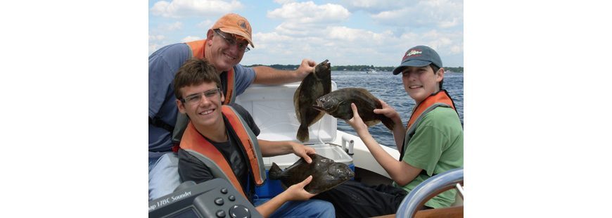 Dr. Jonathan Hare shown in 2013 with his son Jon (far right) and friend Elliot Emperor fishing with Capt. Dave Monti on No Fluke Charters.