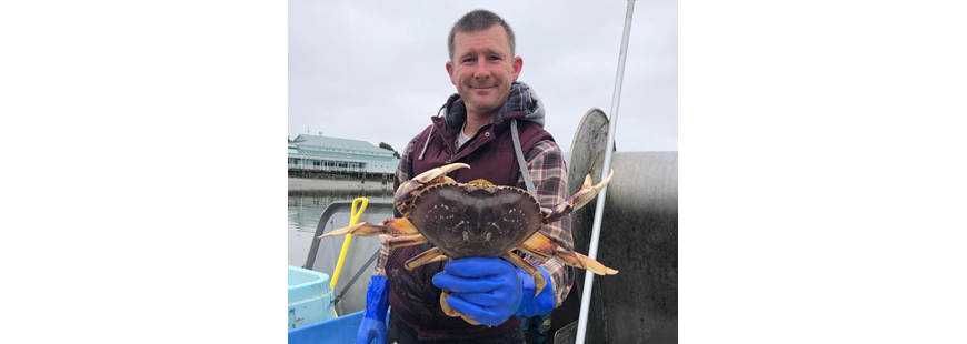 Harrison Ibach and his freshly caught live Dungeness crab.